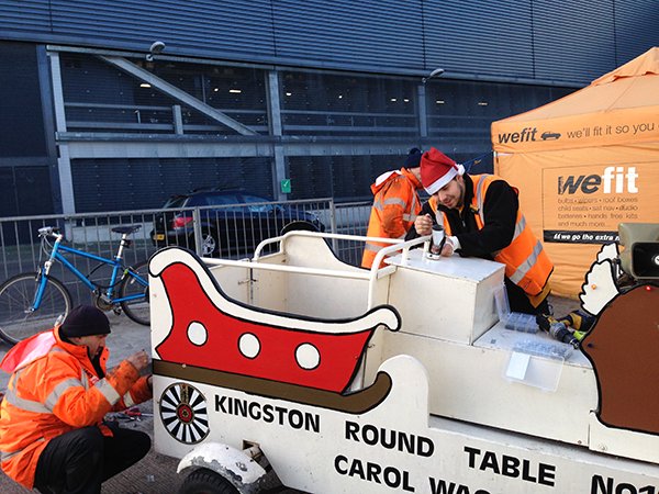 The men of Halford's New Malden make the Carol Wagon ready for the road