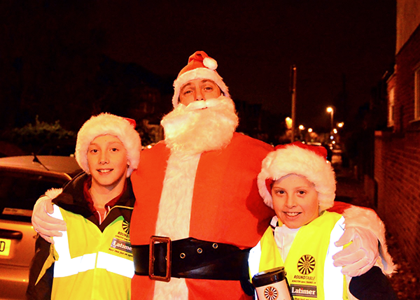 A photo of Santa with his helpers, Jamie and Chad